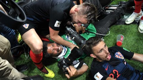 A photographer is knocked over by members of the Croatian team as they celebrate the late Mandzukic goal.