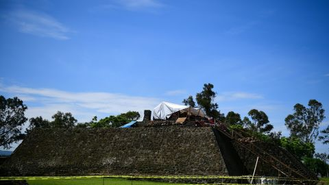 A team works on the top of the Teopanzolco pyramid in Morelos State, Mexico, on Wednesday. Damage caused by a 2017 earthquake revealed a substructure inside then pyramid.