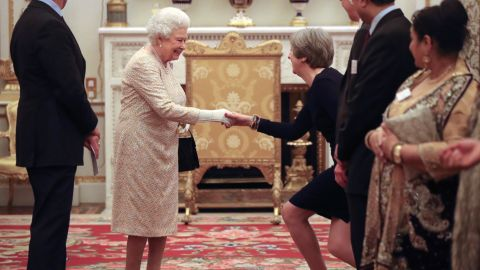 LONDON, UNITED KINGDOM - FEBRUARY 14: Queen Elizabeth II greets Prime Minister Theresa May at a reception to celebrate the Commonwealth Diaspora community, in the lead up to the Commonwealth Heads of Government meeting in London this April, at Buckingham Palace on February 14, 2018 in London, England. (Photo by Jonathan Brady - Pool/Getty Images)