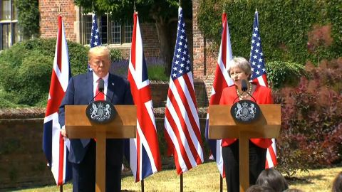 Trump/London/UK/Pool Path 2 THERESA MAY PM UK HOLDING HANDS ON WAY TO PRESSER