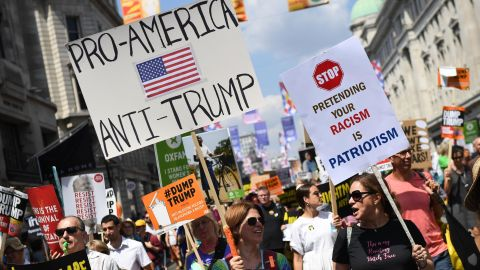LONDON, ENGLAND - JULY 13:  Protesters join a Women's march in central London to demonstrate against President Trump's visit to the UK, on July 13, 2018 in London, England. Tens of Thousands Of Anti-Trump protesters are expected to demonstrate in London and across the country against the UK visit by the President of the United States. Many people disagree with his policies that include migrant family separation, discrimination of transgender military personnel and changes to laws protecting women's sexual health.  (Photo by Chris J Ratcliffe/Getty Images)