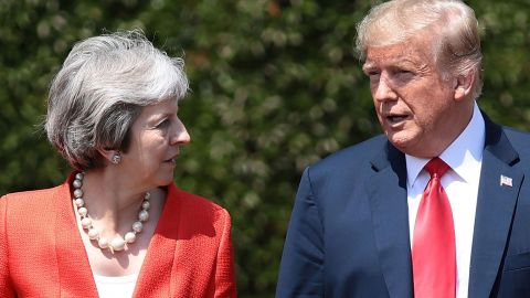"""US President Donald Trump (R) and Britain's Prime Minister Theresa May (L) walk together after holding a meeting at Chequers, the prime minister's country residence, near Ellesborough, northwest of London on July 13, 2018 on the second day of Trump's UK visit. - US President Donald Trump launched an extraordinary attack on Prime Minister Theresa May's Brexit strategy, plunging the transatlantic """"special relationship"""" to a new low as they prepared to meet Friday on the second day of his tumultuous trip to Britain. (Photo by Jack Taylor / POOL / AFP)        (Photo credit should read JACK TAYLOR/AFP/Getty Images)"""
