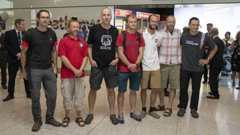 Divers and rescuers from the Thai cave mission arrive at Heathrow Airport Friday. From left to right: Chris Jewell, Mike Clayton, Rick Stanton, Lance-corporal Connor Roe, Josh Bratchley, Gary Mitchell and Jim Warny
