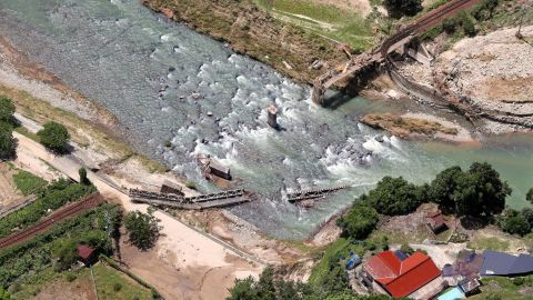 This aerial image shows the destroyed iron bridge of JR Geibi Line due to  torrential rains in Hiroshima.