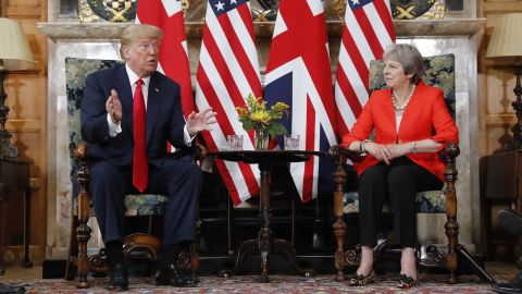 U.S. President Donald Trump, left, gestures while speaking during their meeting with with British Prime Minister Theresa May, right, at Chequers, in Buckinghamshire, England, Friday, July 13, 2018. (AP Photo/Pablo Martinez Monsivais)