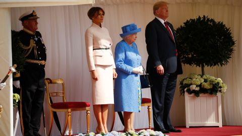 U.S. President Donald Trump, first lady Melania Trump, with Queen Elizabeth II, stand during an arrival ceremony with the Guard of Honour at Windsor Castle in Windsor, England, Friday, July 13, 2018. (AP Photo/Pablo Martinez Monsivais)