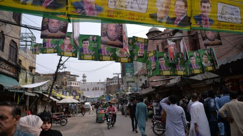 Supporters of Pakistan's ousted Prime Minister Nawaz Sharif and his younger brother Shahbaz Sharif gather at the venue where the younger Sharif would lead a rally.