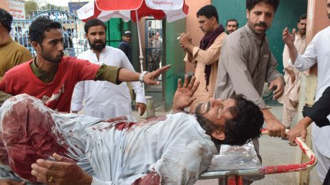 An injured Pakistani man is brought to a hospital in Quetta on Friday following the bomb blast.