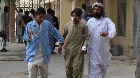 A victim of the bomb blast in Balochistan is brought to a hospital in Quetta on Friday.