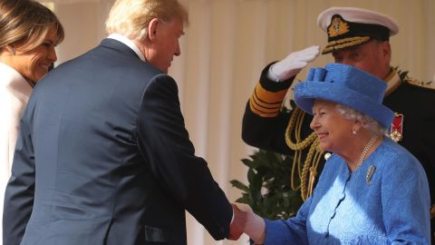 """US First Lady Melania Trump (L) stands by as US President Donald Trump (2L) shakes hands with Britain's Queen Elizabeth II (R) on the dias as they arrive at Windsor Castle in Windsor, west of London, on July 13, 2018 for an engagement on the second day of Trump's UK visit. - US President Donald Trump launched an extraordinary attack on Prime Minister Theresa May's Brexit strategy, plunging the transatlantic """"special relationship"""" to a new low as they prepared to meet Friday on the second day of his tumultuous trip to Britain. (Photo by Chris Jackson / POOL / Getty Images)        (Photo credit should read CHRIS JACKSON/AFP/Getty Images)"""