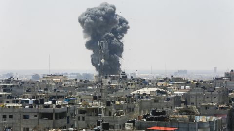 A picture taken on July 14, 2018 shows a smoke plume rising following an Israeli air strike in the southern Gaza Strip city of Rafah, near the border with Egypt. - Israel's military said it had launched air strikes targeting Hamas in the Gaza Strip on July 14 as rockets and mortars were lobbed into southern Israel from the blockaded Palestinian enclave. (Photo by SAID KHATIB / AFP)        (Photo credit should read SAID KHATIB/AFP/Getty Images)