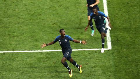 Paul Pogba, bottom, runs to the corner after scoring France's third goal.