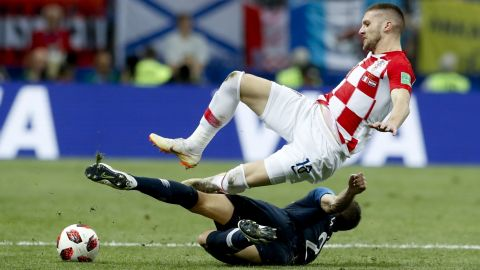 France's Lucas Hernandez tackles Ante Rebic.