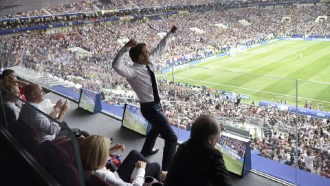 French President Emmanuel Macron shows his excitement while watching the match.