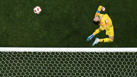 French goalkeeper Hugo Lloris makes a jumping save against Croatia.