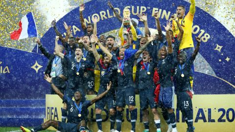 French players celebrate with the World Cup trophy after defeating Croatia in the final on Sunday, July 15.