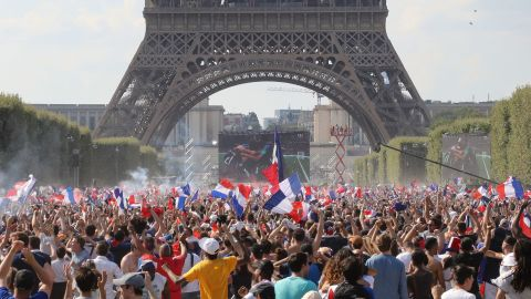 TOPSHOT - France supporters cheer on the fan zone as they watch the Russia 2018 World Cup final football match between France and Croatia, on the Champ de Mars in Paris on July 15, 2018. (Photo by JACQUES DEMARTHON / AFP)        (Photo credit should read JACQUES DEMARTHON/AFP/Getty Images)