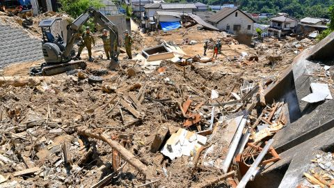 HIROSHIMA, JAPAN - JULY 15:  (CHINA OUT, SOUTH KOREA OUT) Self-Defense Force members continue searching operation on July 15, 2018 in Hiroshima, Japan. More than 100 people were treated for heatstroke as scorching summer heat baked western Japan prefectures hit by recent torrential deluges.  (Photo by The Asahi Shimbun via Getty Images)