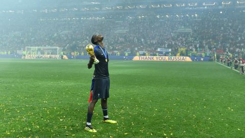 French midfielder Paul Pogba celebrates with the trophy.