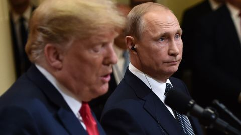 US President Donald Trump and Russia's President Vladimir Putin attend a joint press conference after a meeting at the Presidential Palace in Helsinki, on July 16, 2018. (Photo by Brendan SMIALOWSKI / AFP)        (Photo credit should read BRENDAN SMIALOWSKI/AFP/Getty Images)