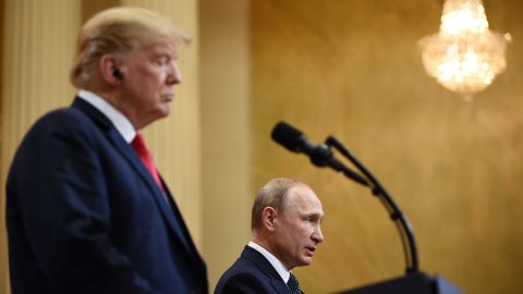 """US President Donald Trump (L) and Russia's President Vladimir Putin attend a joint press conference after a meeting at the Presidential Palace in Helsinki, on July 16, 2018. - The US and Russian leaders opened an historic summit in Helsinki, with Donald Trump promising an """"extraordinary relationship"""" and Vladimir Putin saying it was high time to thrash out disputes around the world. (Photo by Brendan SMIALOWSKI / AFP)        (Photo credit should read BRENDAN SMIALOWSKI/AFP/Getty Images)"""
