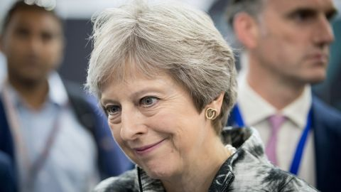 Britain's Prime Minister Theresa May speaks with guests as she opens the Farnborough Airshow, south west of London, on July 16, 2018. - Britain sought to project an image of aerospace prowess long after it leaves the European Union, at the Farnborough airshow on Monday, as Airbus and Boeing announced a raft of deals and issued optimistic outlooks for the global industry. (Photo by Matt Cardy / POOL / Getty Images)        (Photo credit should read MATT CARDY/AFP/Getty Images)