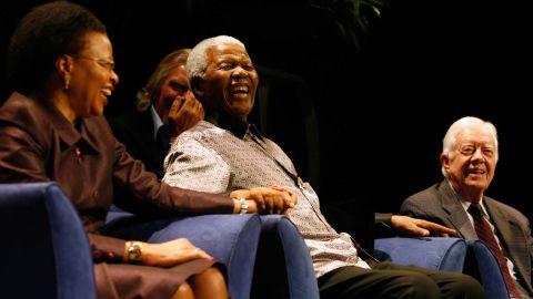 Graça Machel, Richard Branson (background), Nelson Mandela and Jimmy Carter at the public launch of The Elders in Johannesburg on July 18, 2007.