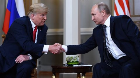 TOPSHOT - Russian President Vladimir Putin (R) and US President Donald Trump shake hands before a meeting in Helsinki, on July 16, 2018. (Photo by Brendan Smialowski / AFP)        (Photo credit should read BRENDAN SMIALOWSKI/AFP/Getty Images)