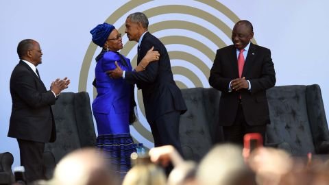 Nelaon Mandela's widow, Graça Machel, center left, greeting Barack Obama on Tuesday.