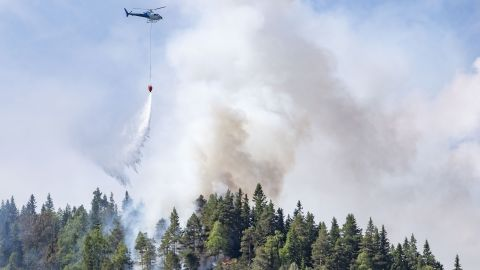 Firefighters use helicopters to fight wildfires in the southern part of Norway in Sordal on July 14.