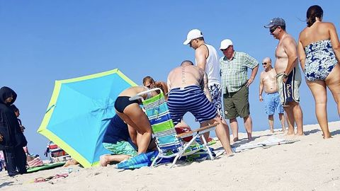 The rod of the umbrella was cut off on the beach so Margaret Reynolds could be taken to the hospital.