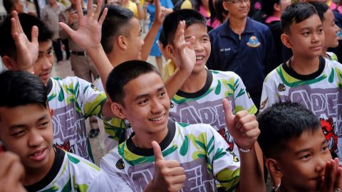 """CHIANG RAI, THAILAND - JULY 18:  Twelve boys and their coach from the """"Wild Boars"""" soccer team arrive for a press conference for the first time since they were rescued from a cave in northern Thailand last week, on July 18, 2018 in Chiang Rai, Thailand. The 12 boys, aged 11 to 16, and their 25-year-old coach were discharged early from Chiang Rai Prachanukroh hospital after a speedy recovery and thanked those involved in their rescue. (Photo by Linh Pham/Getty Images)"""