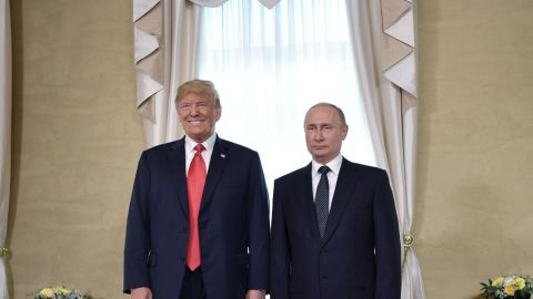 """US President Donald Trump (L) and Russia's President Vladimir Putin pose ahead a meeting in Helsinki, on July 16, 2018. - The US and Russian leaders opened an historic summit in Helsinki, with Donald Trump promising an """"extraordinary relationship"""" and Vladimir Putin saying it was high time to thrash out disputes around the world. (Photo by Alexey NIKOLSKY / Sputnik / AFP)        (Photo credit should read ALEXEY NIKOLSKY/AFP/Getty Images)"""