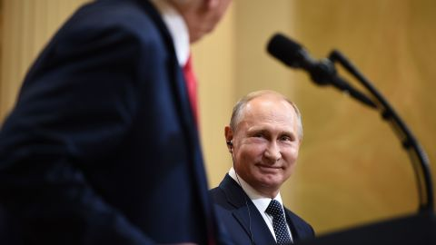 US President Donald Trump and Russia's President Vladimir Putin attend a joint press conference after a meeting at the Presidential Palace in Helsinki, on July 16, 2018. (Photo by BRENDAN SMIALOWSKI/AFP/Getty Images)
