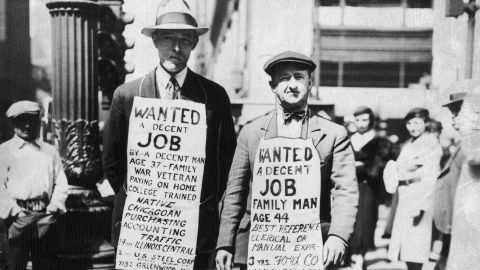 Two men wearing sandwich boards advertising their willingness to find employment - 'Wanted, a decent job' - in Chicago during the Great Depression. Chicago, Illinois, USA, 15 April 1934. (Photo by FotosearchGetty Images).
