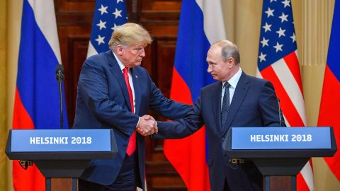 US President Donald Trump (L) and Russia's President Vladimir Putin shake hands before attending a joint press conference after a meeting at the Presidential Palace in Helsinki, on July 16, 2018. (Photo by YURI KADOBNOV/AFP/Getty Images)