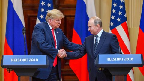 """US President Donald Trump (L) and Russia's President Vladimir Putin shake hands before attending a joint press conference after a meeting at the Presidential Palace in Helsinki, on July 16, 2018. - The US and Russian leaders opened an historic summit in Helsinki, with Donald Trump promising an """"extraordinary relationship"""" and Vladimir Putin saying it was high time to thrash out disputes around the world. (Photo by Yuri KADOBNOV / AFP)        (Photo credit should read YURI KADOBNOV/AFP/Getty Images)"""