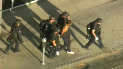 Aerial footage showed police leading the suspect away in handcuffs.