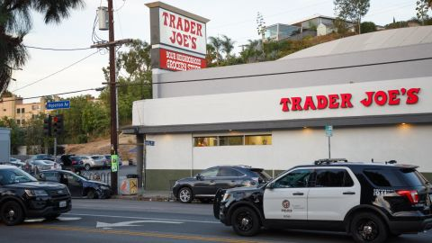epa06903638 Police investigate the aftermath of a hostage situation at the Trader Joes grocery store in the Silver Lake neighborhood of Los Angeles, California, USA, 21 July 2018. A gunman crashed his car into the utility pole outside the store before surrendering to authorities. One person was killed in the store during a gun battle with police that started earlier in the day with a domestic dispute.  EPA/EUGENE GARCIA