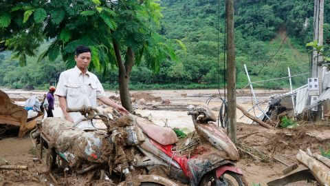 A man looks at motorbikes damaged by flash flooding in Vietnam's Yen Bai province on July 21, 2018. - At least 10 people have died after floods spurred by typhoon rains struck central and northern Vietnam, authorities said on July 21. (Photo by Anh TUAN / AFP)        (Photo credit should read ANH TUAN/AFP/Getty Images)
