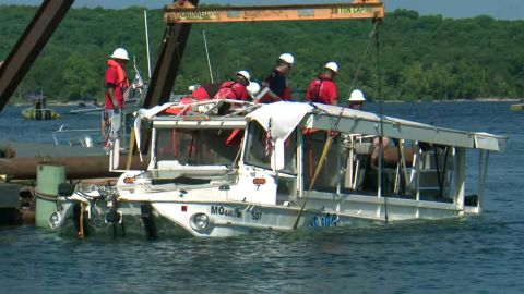 A duck boat that sank in Branson, Missouri, is raised out of the water.