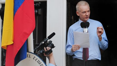 """Assange addresses the media and his supporters from the balcony of the Ecuadorian Embassy in London on August 19, 2012. A few days earlier, Ecuador announced that it had granted asylum to Assange. In his public address, Assange demanded that the United States drop its """"witch hunt"""" against WikiLeaks."""