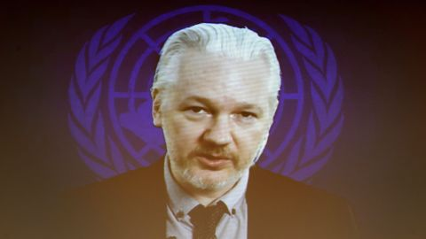 Assange is seen on a video screen in March 2015, during an event on the sideline of a United Nations Human Rights Council session.