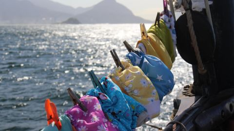 """Theo's reusable nappies drying aboard the boat. """"They dried very quickly in hot climates,"""" said Katharine. """"Conventional nappies don't really work as most boats don't have enough space to store them and also they stink!"""""""