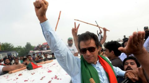 Pakistani cricketer-turned-politician Imran Khan gestures as he leads a protest march to Islamabad against the country's Pakistan Muslim League-Nawaz-led government in Wazirabad in eastern Punjab province on August 15, 2014. Clashes broke out on August 15, 2014 as protesters led in convoys by cricketer-turned-politician Imran Khan and a populist cleric advanced on the Pakistani capital to try to topple the government they say was elected by fraud. Khan and preacher Tahir-ul-Qadri say the May 2013 general election that brought Prime Minister Nawaz Sharif to power in a landslide was rigged, and are demanding he resign and hold new polls. AFP PHOTO/Asif HASSAN        (Photo credit should read ASIF HASSAN/AFP/Getty Images)