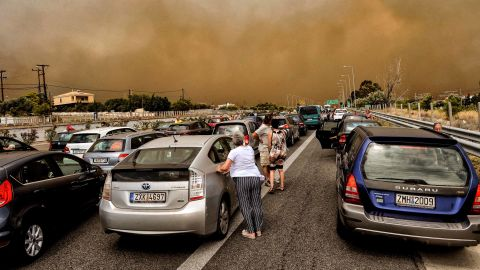 The fire causes a huge traffic jam near Kineta as people try to escape the flames on July 23.