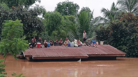 Lao villagers stranded on a roof of a house in Attapeu province on 24 July.
