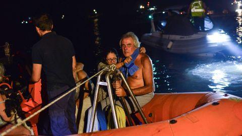 Rescuers and volunteers help residents evacuate Mati on July 23.