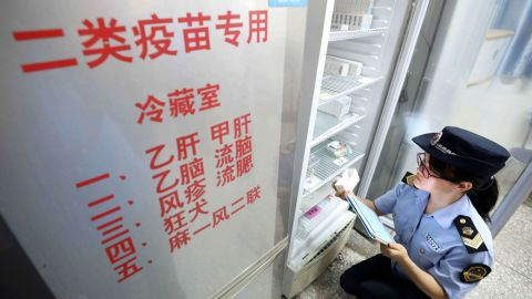 A local market supervisory authority official checks on vaccines at a hospital in Rongan in China's southern Guangxi region on July 23, 2018. - Chinese Premier Li Keqiang has vowed stern action over the latest safety scare to hit the country's pharmaceutical industry, as a mounting scandal over a rabies vaccine sent drug stocks tumbling. (Photo by - / AFP) / China OUT / The erroneous mention[s] appearing in the metadata of this photo by - has been modified in AFP systems in the following manner: [local market supervisory authority official] instead of [Food and Drug Administration officer]. Please immediately remove the erroneous mention[s] from all your online services and delete it (them) from your servers. If you have been authorized by AFP to distribute it (them) to third parties, please ensure that the same actions are carried out by them. Failure to promptly comply with these instructions will entail liability on your part for any continued or post notification usage. Therefore we thank you very much for all your attention and prompt action. We are sorry for the inconvenience this notification may cause and remain at your disposal for any further information you may require.        (Photo credit should read -/AFP/Getty Images)