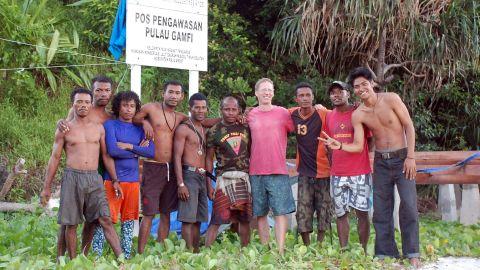 Jamie mixes with locals at Gamfi island, part of the Raja Ampat archipelago in Indonesia.